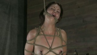 Bondage fan Sarah Shevon moans while being hung above the floor