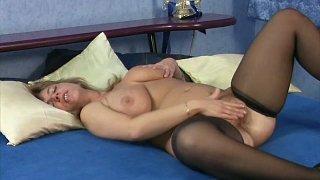 Horny Brenda wanks on a bed rubbing her wet twat